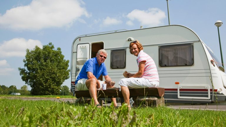 couple-outside-caravan