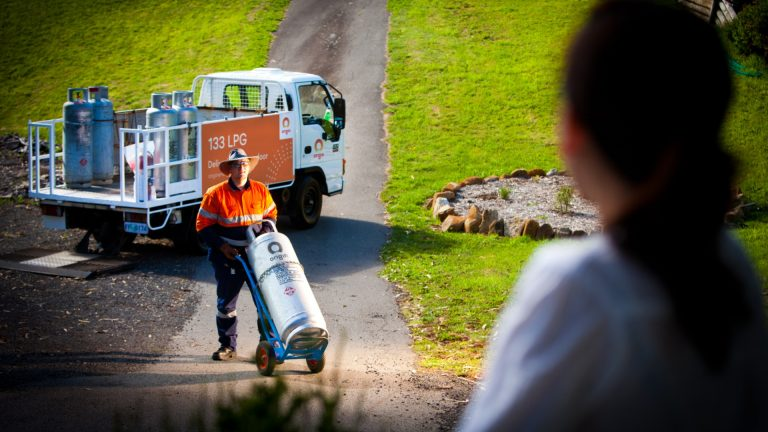 lpg-delivery-driver-wheeling-gas-bottle